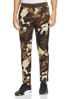 1fceec5df453 PUMA Wild Pack T7 Camouflage-Print Track Pants