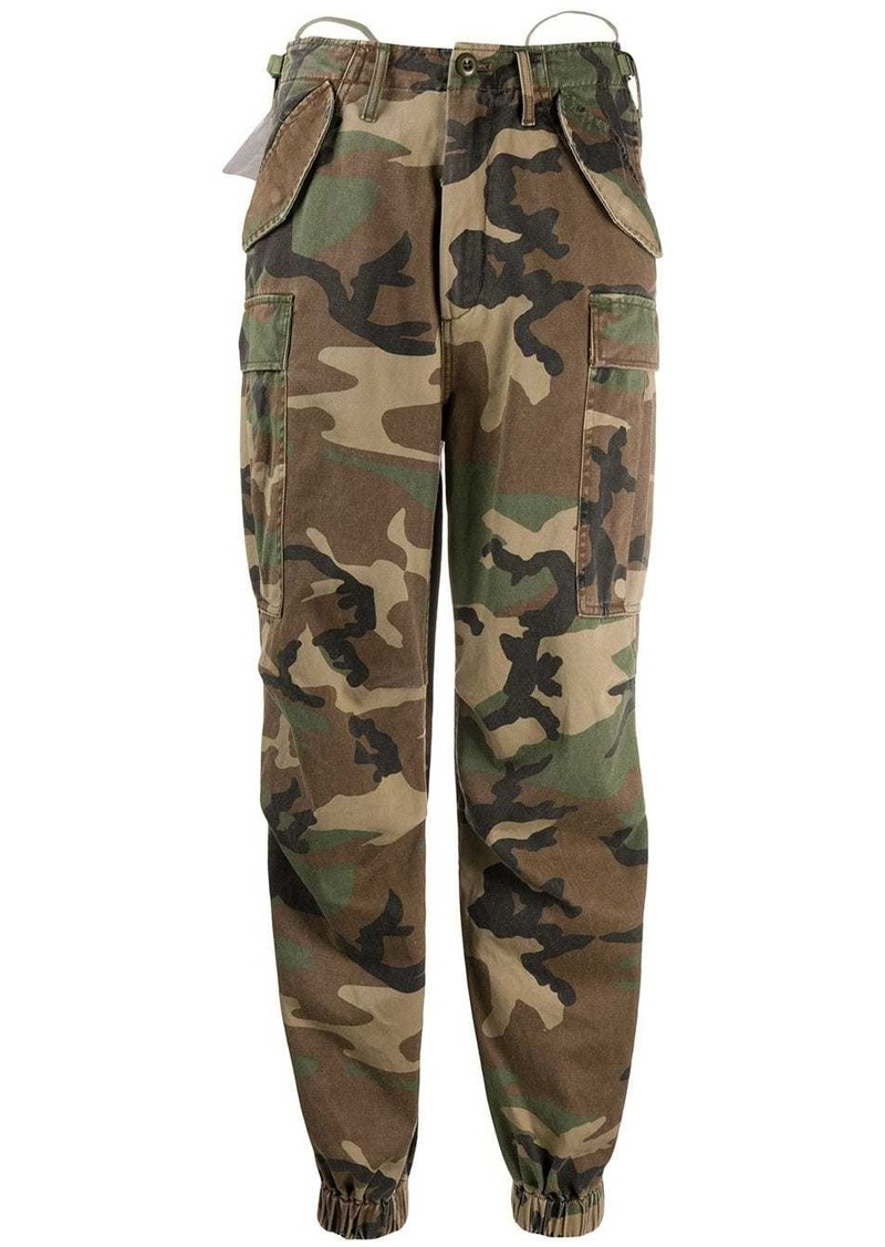 R13 camouflage print tapered trousers