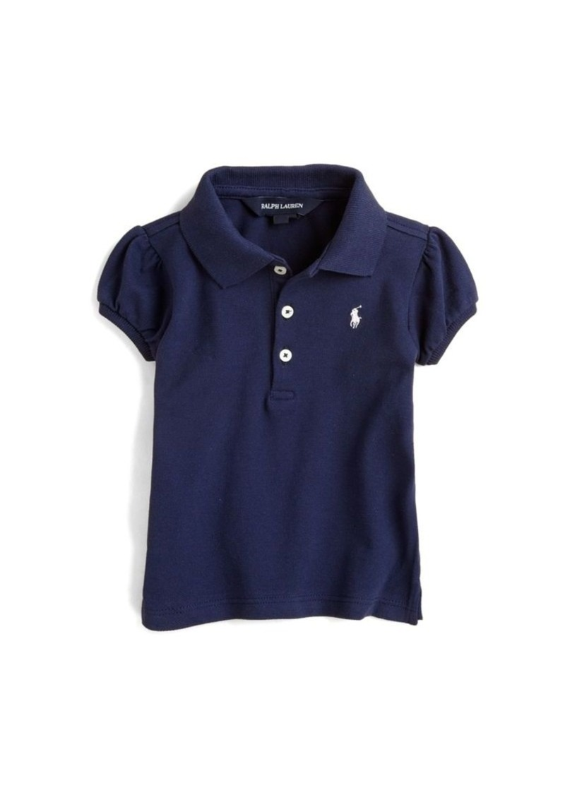 A high-quality polo shirt can be the perfect thing for him to wear to picture day at school. A pair of khakis completes the look. Boys' polos are also ideal if your little man's school has a conservative dress code.
