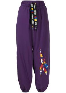 Reebok geometric logo track trousers