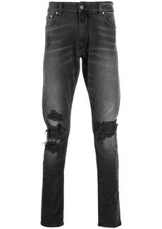 Represent distressed design jeans