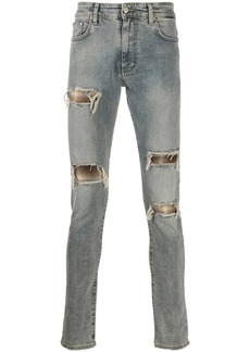 Represent distressed flannel-layered jeans