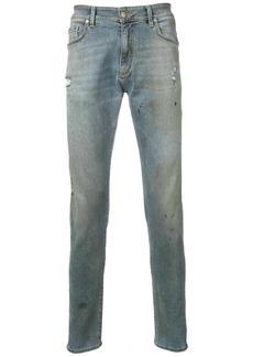 Represent distressed skinny jeans