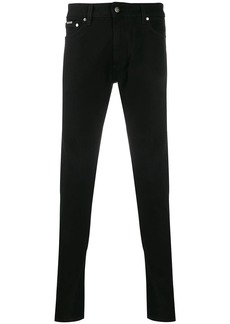 Represent mid-rise skinny jeans