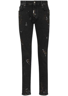 Represent paint-effect mid-rise jeans