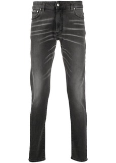Represent whiskered slim-fit jeans