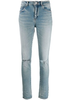 Saint Laurent high rise ripped knee jeans