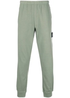 Stone Island side logo patch track pants