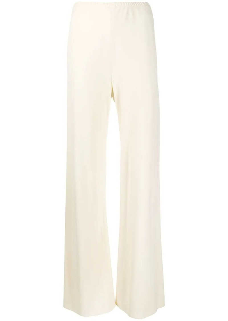 The Row flared trousers