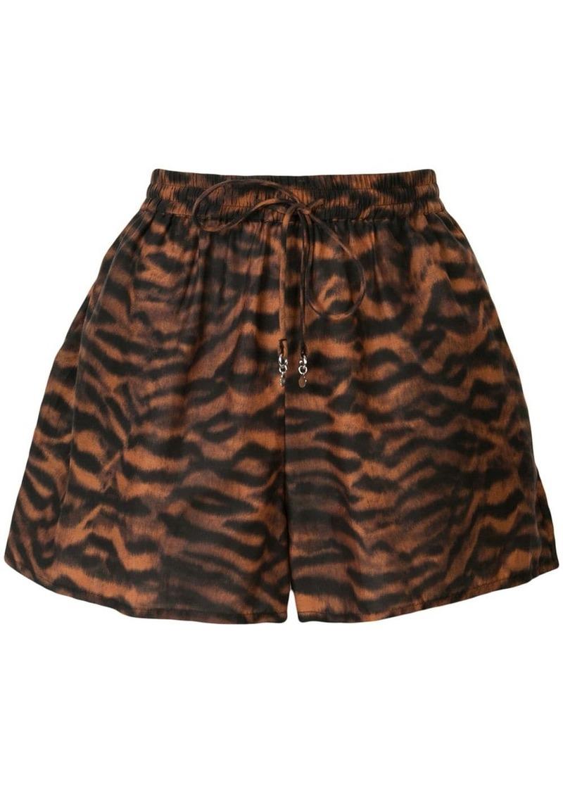 The Upside Ola tiger-pattern shorts