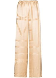 Totême tonal-monogram silk palazzo pants