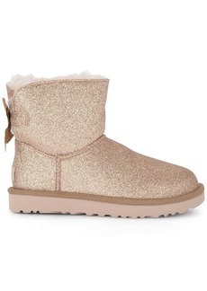 Ugg Mini Bailey Bow Sheepskin And Golden Glitter Ankle Boots