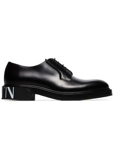 Valentino Garavani black logo print leather Derby shoes