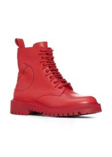 VALENTINO GARAVANI Logo Embossed Combat Boot (Women)
