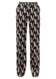 Valentino High-rise V-print silk-satin trousers