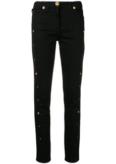 Versace button-embellished skinny jeans