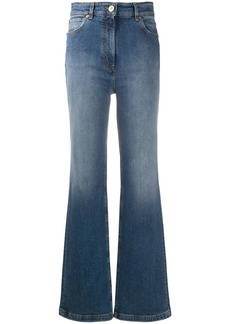 Versace faded-effect flared jeans