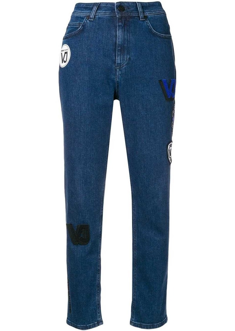 Versace high waisted patch jeans