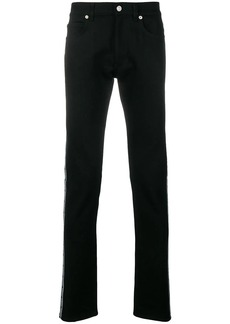 Versace logo-strip jeans