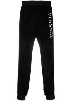 Versace logo stripe print track pants