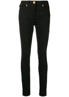 Versace Medusa stud skinny jeans