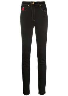 Versace rose-embroidered skinny jeans