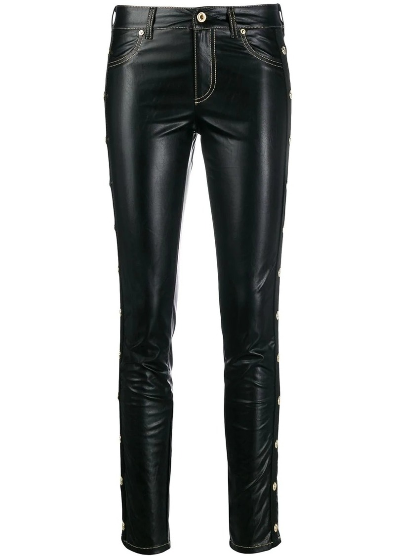 Versace studded skinny fit trousers