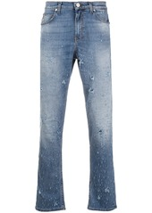 Versace all-over distressed jeans
