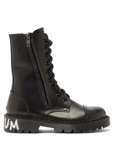 Vetements Dominium In Rectum-print leather boots