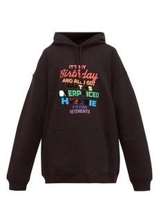Vetements Slogan-print cotton-jersey hooded sweatshirt