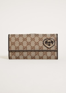 b541cfeeeeb What Goes Around Comes Around Gucci Guccissima Canvas Wallet (Previously  Owned)