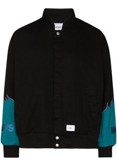 WTAPS Drifters panelled bomber jacket