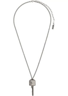 Yves Saint Laurent etched key pendant necklace