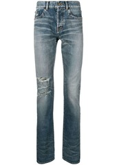 Yves Saint Laurent ripped stonewashed high rise jeans