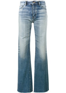 Yves Saint Laurent Saint Laurent raw-cut flared jeans - Blue