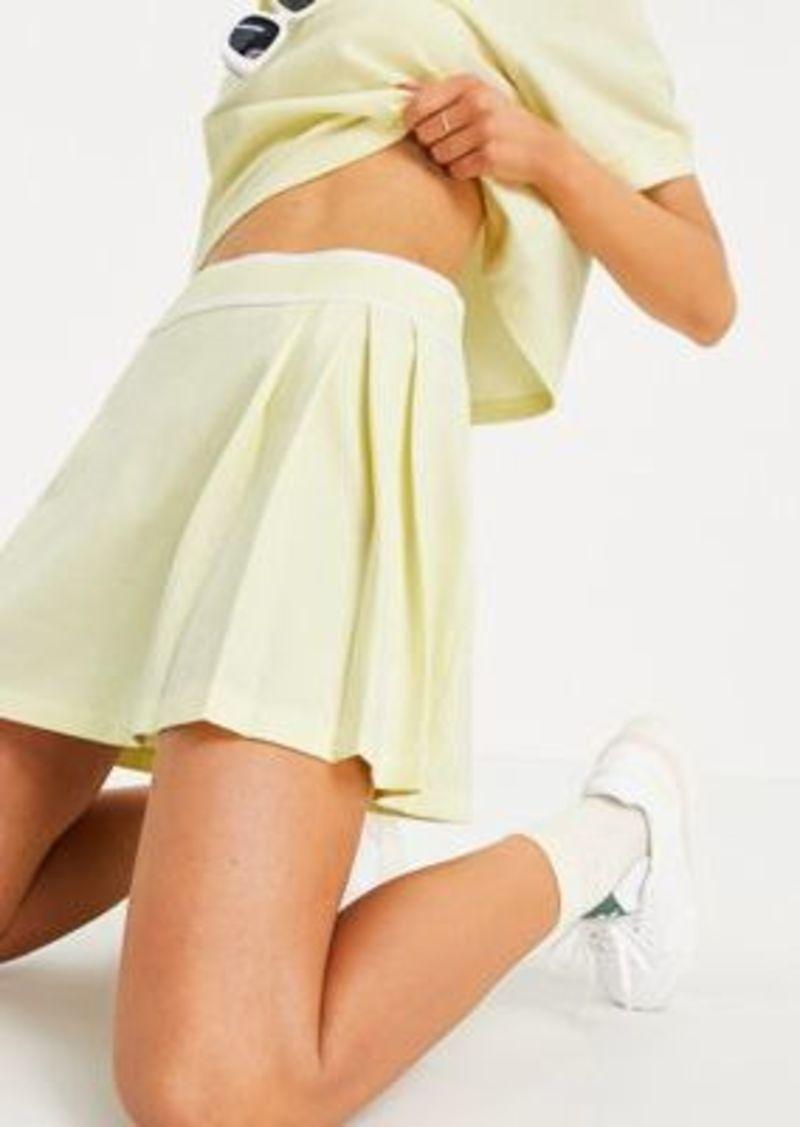 adidas Originals Tennis Luxe logo pleated skirt in hazy yellow