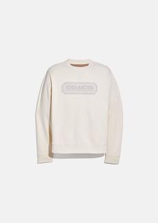 coach badge sweatshirt