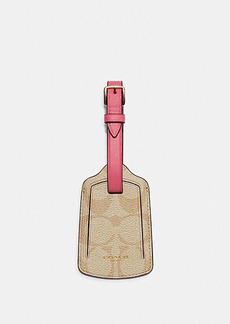 Coach luggage tag in signature canvas