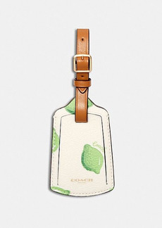 Coach luggage tag with lime print