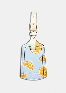 Coach luggage tag with orange print