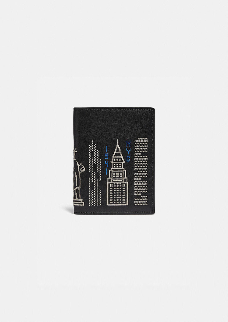 Coach passport case with stardust city skyline