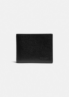 Coach slim billfold wallet with signature canvas detail