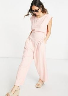 Free People heat wave relaxed jumpsuit in grapefruit