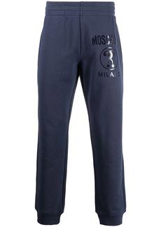 Moschino Milano print track pants