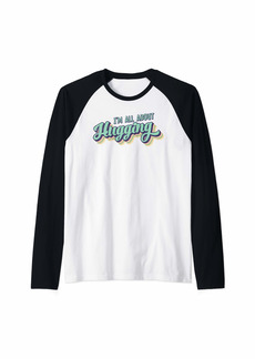I'm All About Hugging Bright 70's Style Rainbows Raglan Baseball Tee