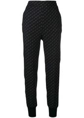 Stella McCartney 'Stella' print tapered trousers