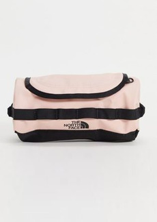 The North Face Base Camp small travel canister wash bag in pink