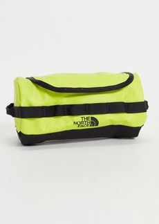 The North Face Base Camp small travel canister wash bag in yellow
